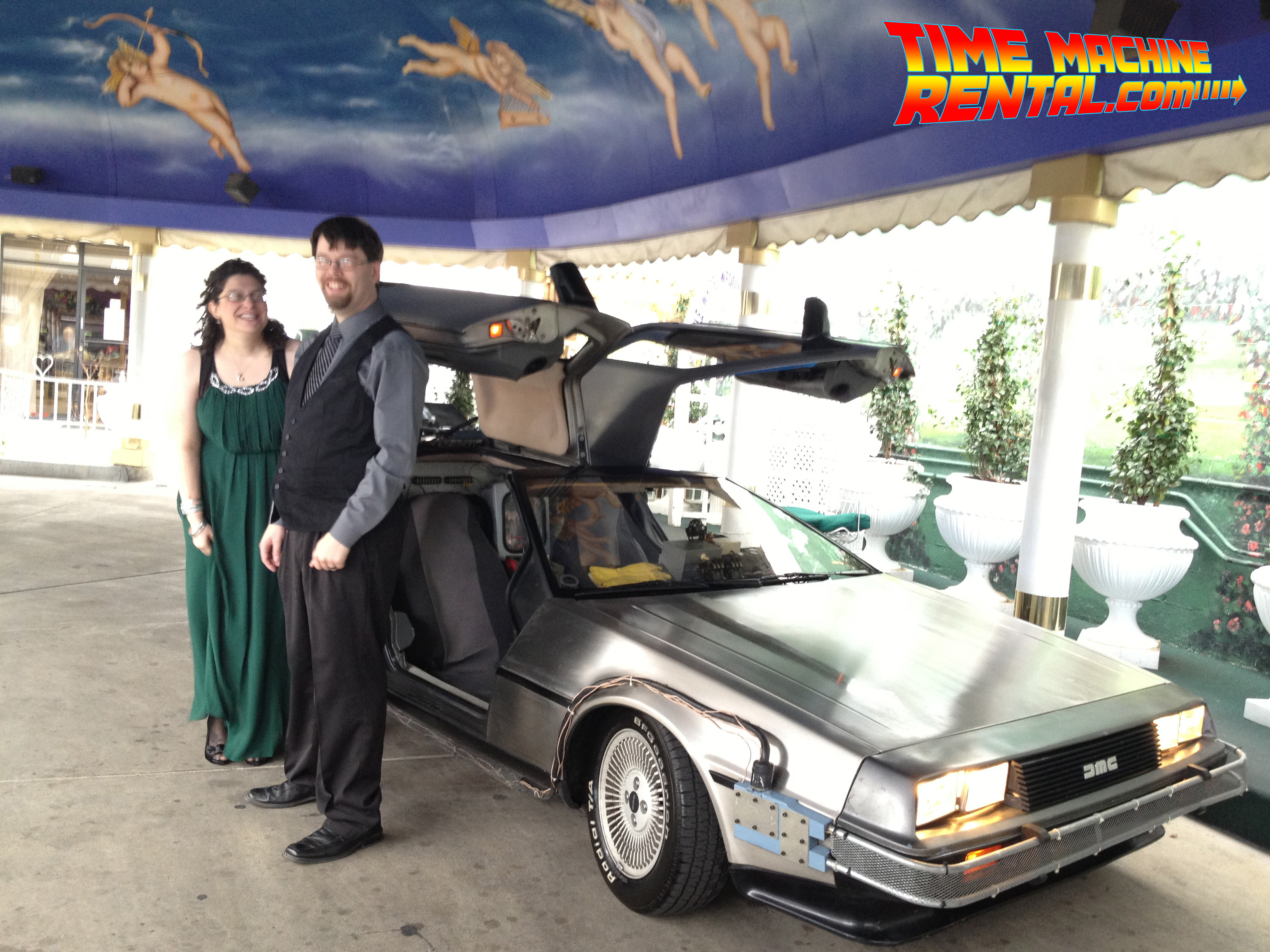 The happy couple posing alongside temporal experiment #2: The Wedding!